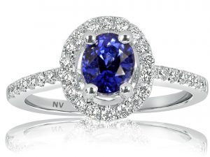 18ct white gold ladies ring set with 1.26ct Ceylon Sapphire and 32=.39ct round brilliant cut diamonds.
