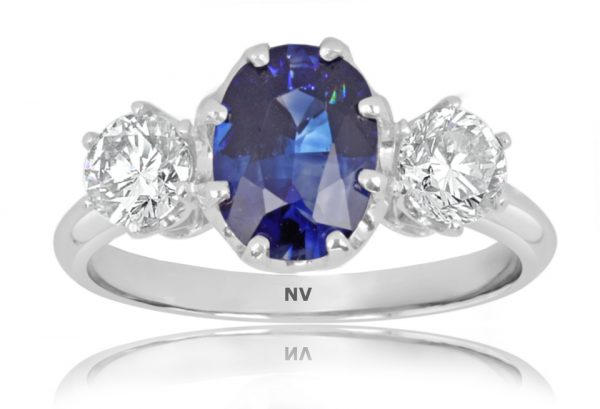 18ct white gold ladies ring set with 1x2.13ct Oval shape Ceylon Sapphire and 2=.71ct round brilliant cut diamonds.
