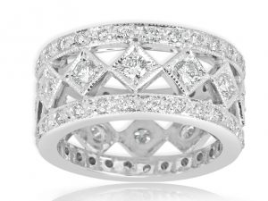 18ct White gold Ladies ring set with 12=.60ct and 54=.55ct round brilliant cut diamonds.