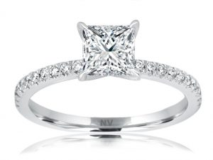 18ct White Gold Ladies engagement ring set with 1x1.03ct Princess cut Diamond, Colour F, Clarity P1 and 22=.20ct round brilliant cut diamonds in fine claw setting.